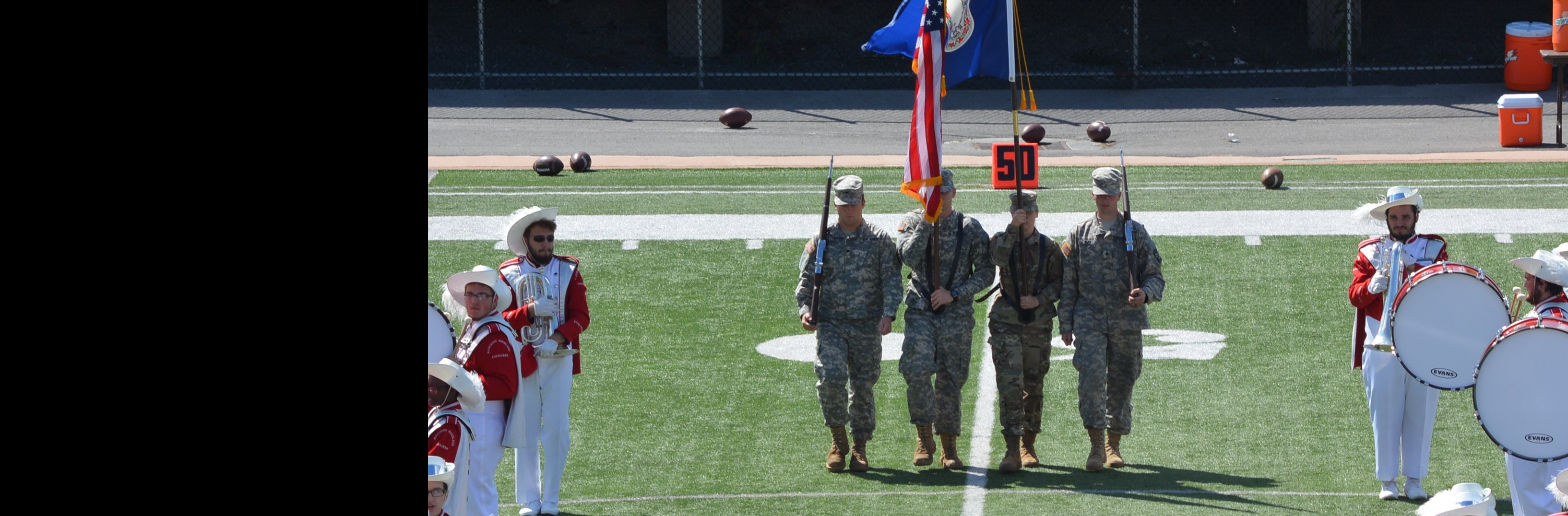 Cadets Buaserman, Mullins, Carico, and Day carry out the US and Virginia state colors to the field at the introduction of the UVA-Wise Football game.